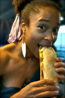 Breeze Harper eating her Vegan Wurst Sandwich from Heart of Joy, coming back from Salzburg, Austria on the train.