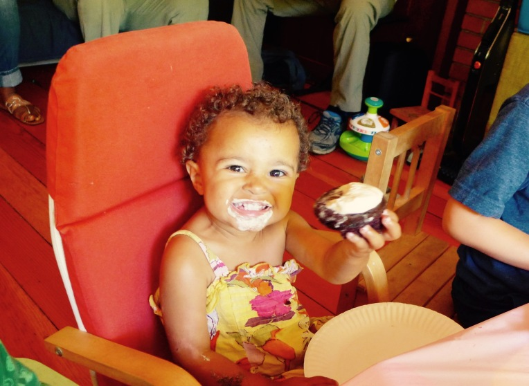 Kira-Satya, My 21 month old daughter, enjoying a cupcake.